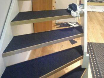 Presentationsbild för referensen Mattläggning i trapp