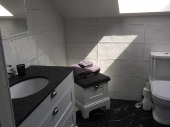 Presentationsbild för referensen Konsument jobb badrum